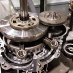 Crank in right-hand crankcase reveals gear-driven crank-speed counterbalance shaft.